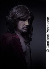 homme, à, longs cheveux, et, manteau noir
