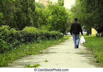 homme, à, sac à provisions