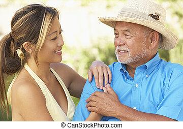 homme aîné, fille, jardin, adulte