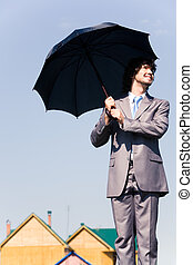 homme affaires, à, parapluie