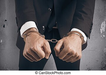 homme affaires, handcuffed