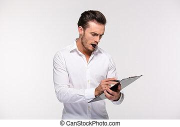 homme affaires, notes, presse-papiers, confection