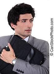 homme affaires, ordinateur portable, sien, bras, tenue