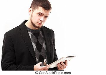 homme affaires, tablette, e-cigarette