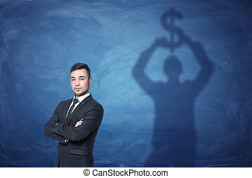 homme affaires tient, et, ombre, sur, les, tableau noir, derrière, lui, tenue, signe dollar, au-dessus, sien, tête