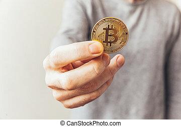 homme, argent, international, currency., payment., tenue, crypto, exploitation minière, bitcoin, toile, cryptocurrency, réseau, virtuel, doré, banque, coin., symbole, concept., main, électronique