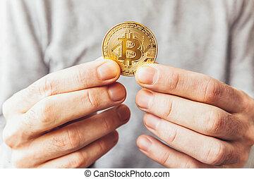 homme, bitcoin, concept., currency., payment., cryptocurrency, virtuel, main, coin., crypto, doré, réseau, argent, banque, toile, exploitation minière, électronique, international, tenue, symbole
