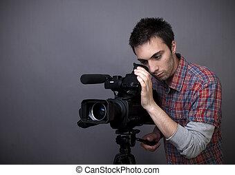 homme, camcorder vidéo, jeune