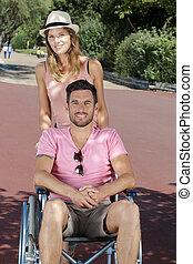 homme, couple, dehors, fauteuil roulant, parc