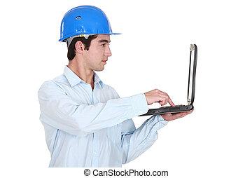homme, dans, a, hardhat, à, a, ordinateur portable