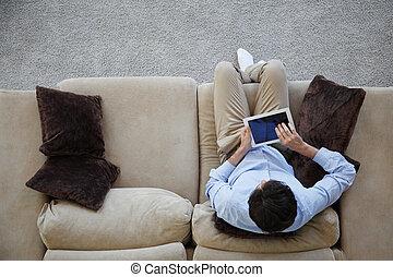 homme, divan, tablette, séance