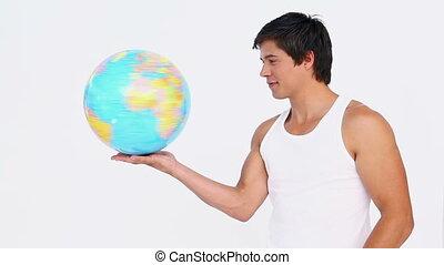 homme, globe, sien, rotations, main