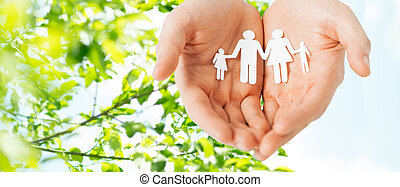 homme, mains, tenant papier, coupure, de, famille
