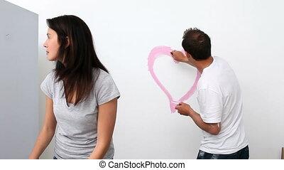 homme, mur, dessin, coeur