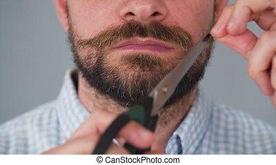 homme, sien, barbu, torsions, moustache, il, fermé, scissors., coupures