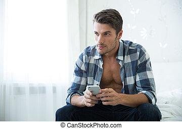 homme, smartphone, lit, séance