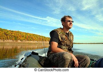 homme, sur, gonflable, bateau, à, moteur