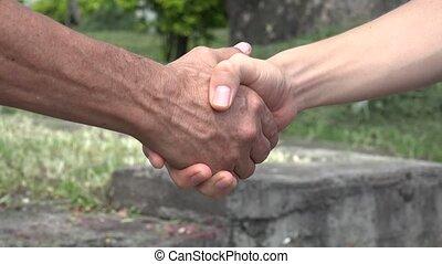 hommes, secousse, deux mains