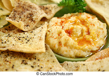 Hommus Dip - Colorful and textured baked pita bread crisps ...