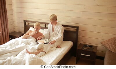 Homosexual couple lying on the bed. lovers kissing