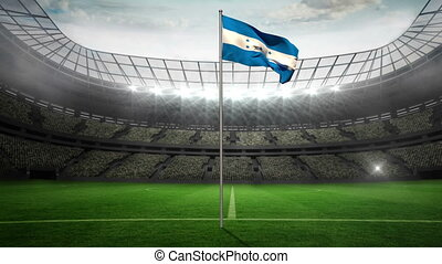 Honduras national flag waving on flagpole in football...