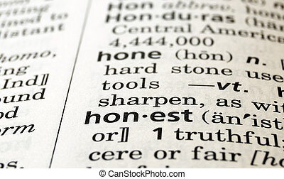 The word honest in a dictionary, close-up