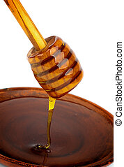 Honey and Dipper - Honey Dripped from Wooden Dipper into...