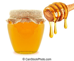Honey and dipper - honey in jar and dipper isolated on white...