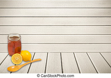 Honey and lemon on a wooden background