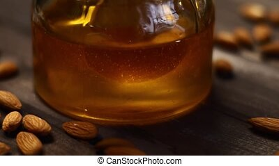 Honey and nuts in slow motion