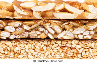 Honey bars with peanuts, sesame seeds and sunflower seeds