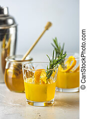 Honey bourbon cocktail with rosemary simple syrup or ...