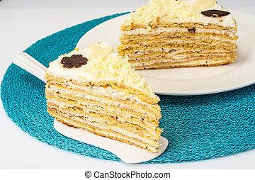 Honey cake with whipped cream and white chocolate