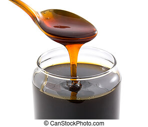 Honey - From glass banks have scooped the spoon of honey. ...