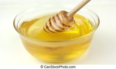 Honey in glass bowl and honey dipper