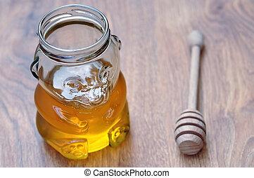 Honey in jar in the shape of teddy bear