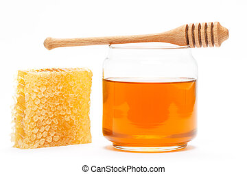 Honey in jar with dipper and honeyc - Honey in glass jar...