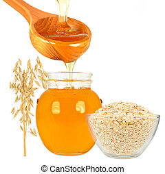honey in jar with ladle and oatmeal on a white background
