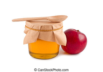 Honey in jar wooden spoon red apple isolated.