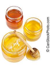 honey in jars isolated