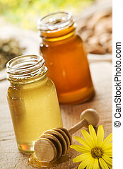 honey in two jars close up shoot