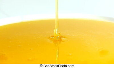 honey is poured into a bowl