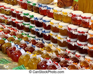 Honey, jam and marmalade - A row of jam, honey and marmalade...