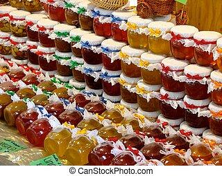 Honey, jam and marmalade - A row of jam, honey and marmalade...