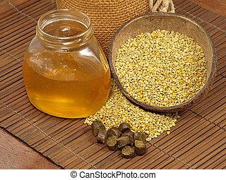 Honey jar, flowers pollen and propolis.