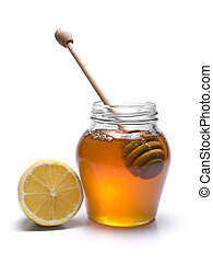 Honey jar - Jar of honey with a wooden drizzler and a lemon....