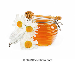 Honey jar with chamomile flowers isolated