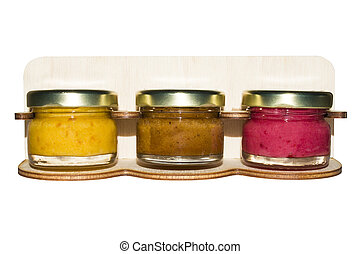 Honey of different tastes in assortment on a white background.