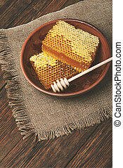 honey on a wooden table, top view