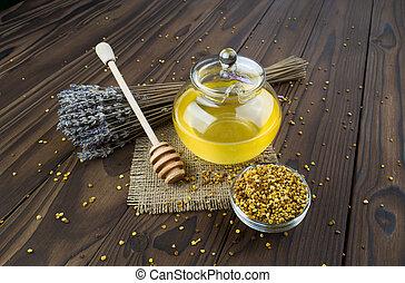 honey  - honey, lavender, pollen on a brown table